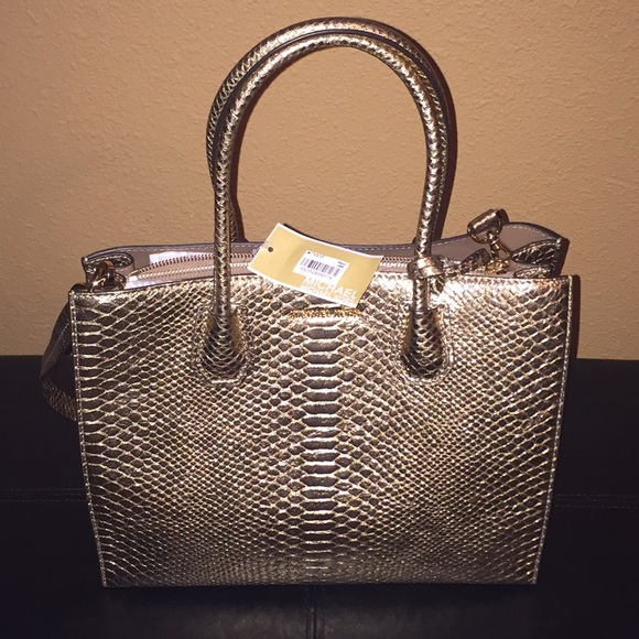 Michael Kors Handbags - Beautiful gold snake embossed MK 1 day sale